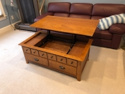 Coffee table showing articulating top
